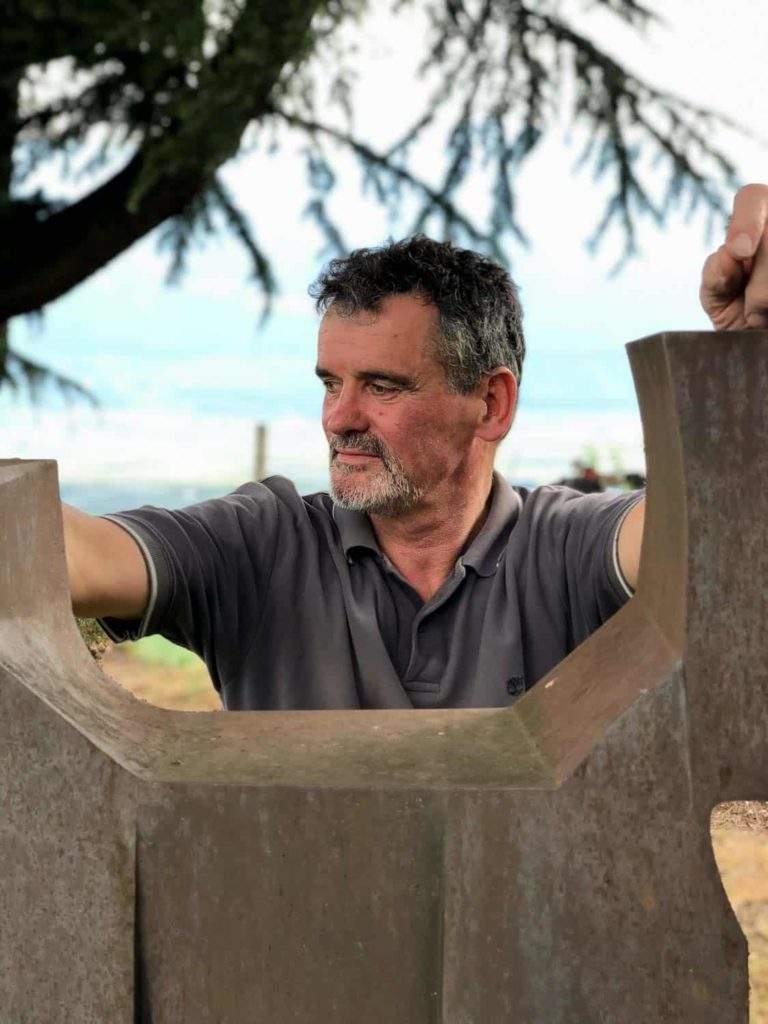 Robert Condin with one of his sculptures.